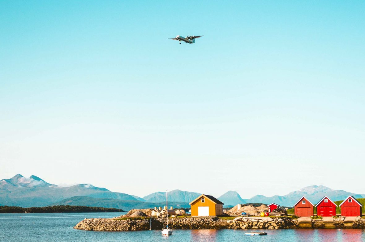 A plane flying over Molde, Norway