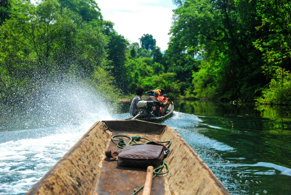 Long boats move quickly through the water on the journey to and from Kong Lor Cave in Laos.