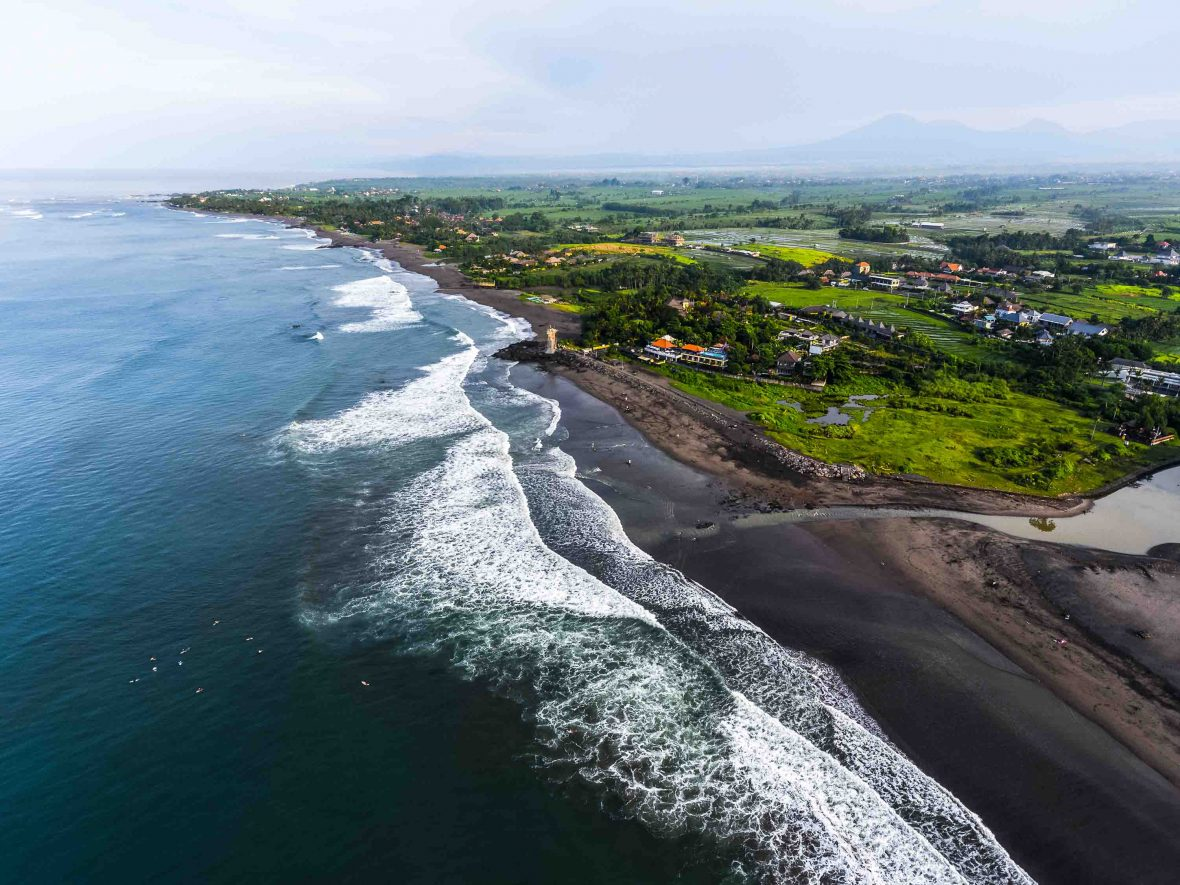 The small town and volcanic beach of Pererenan in Bali.