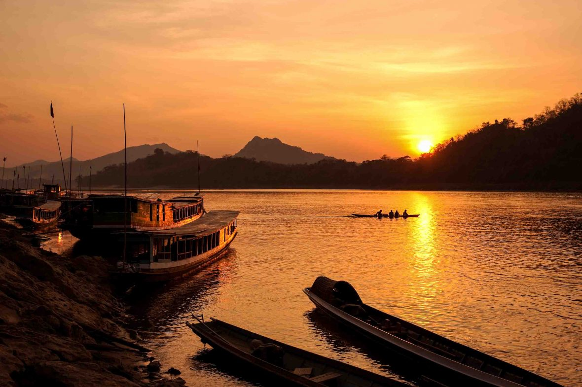 The Mekong River at sunset in Luang Prabang, Laos.