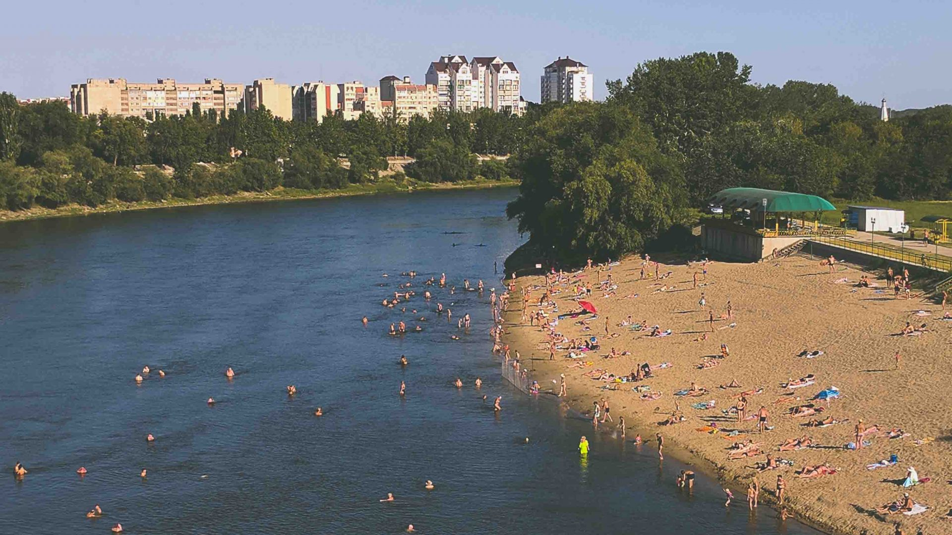 Locals head to the beach by the Dniester River for a 'standing tan' in Transnistria.