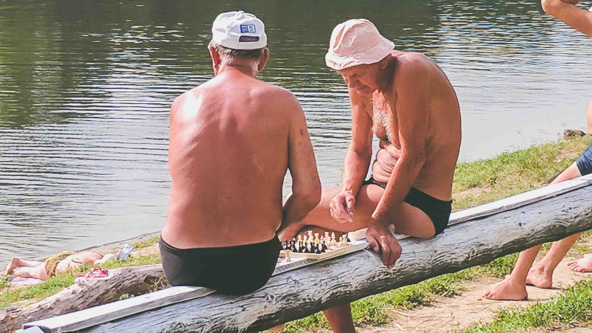 Men play chess by the Dniester River flowing past downtown Tiraspol, Transnistria.