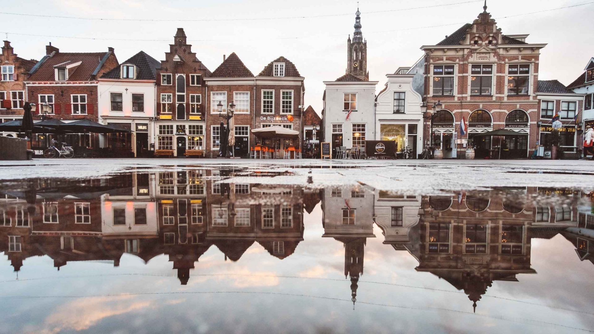 Amsterdam homes reflected in the water after the rains.