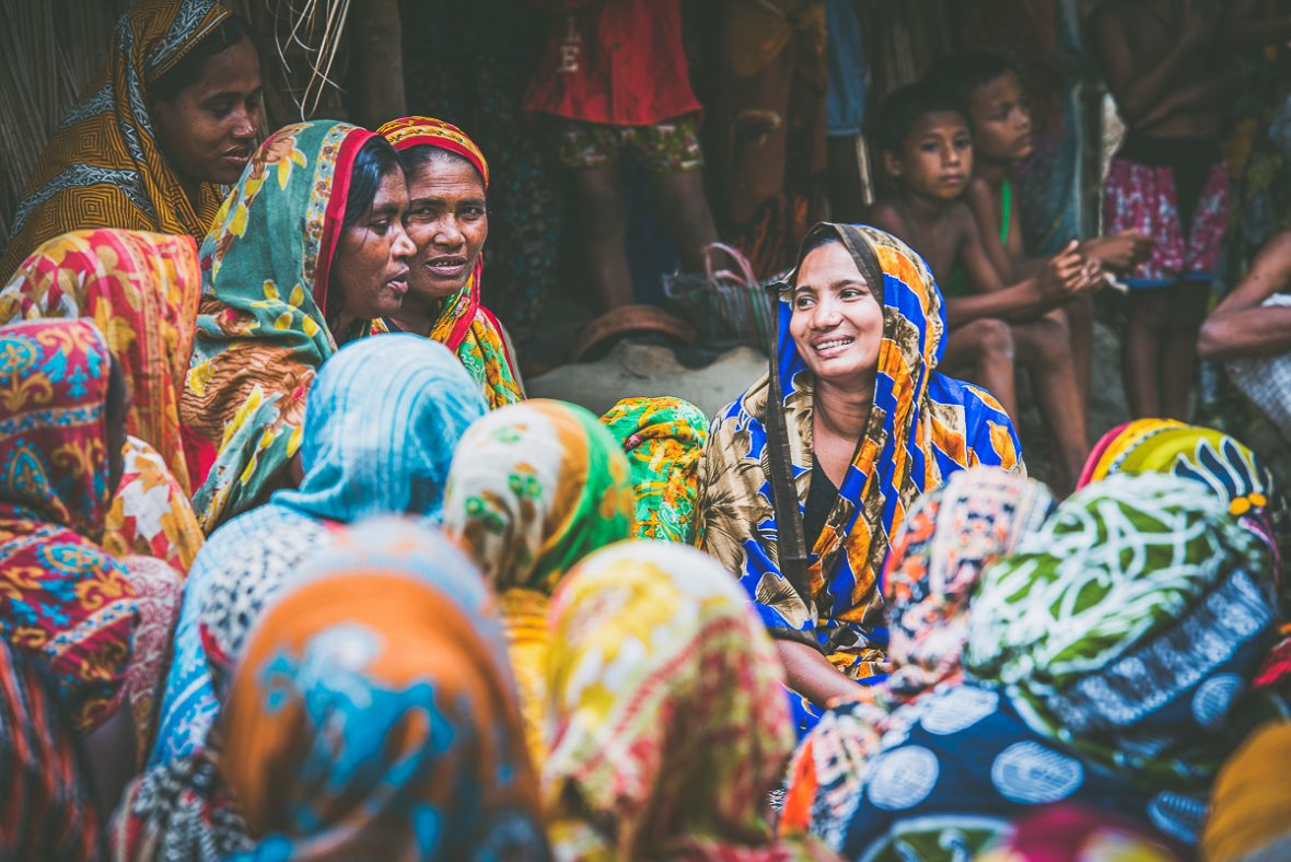 Atika, a woman from one of the lowest castes in Bangladesh, faces a crowd of women who she is educating and informing about their rights.