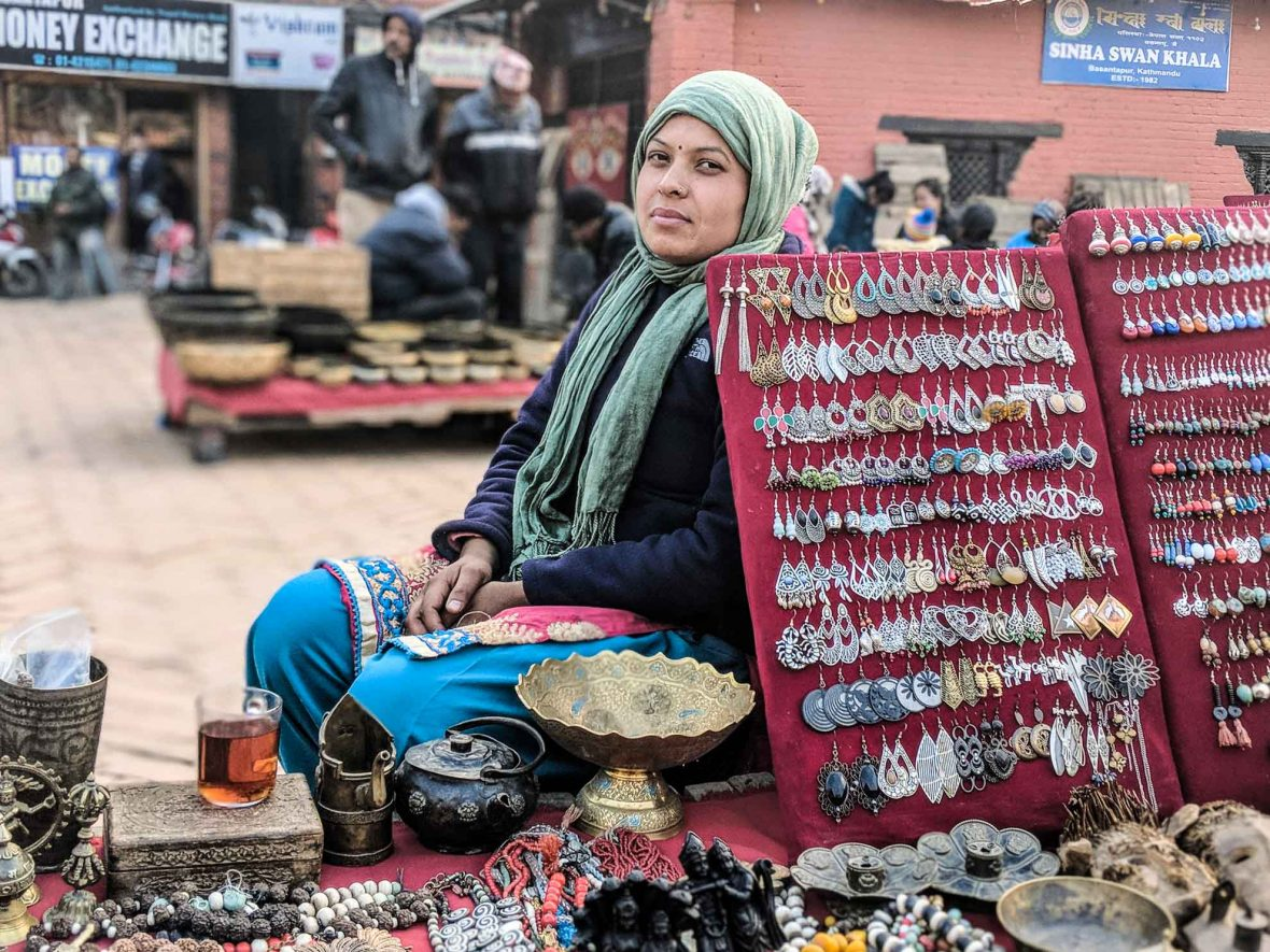 Parvati Budathoki sells jewelery and antiques at a market in Kathmandu's Durbar Square. She has no issues with travelers from wealthy countries haggling over price.