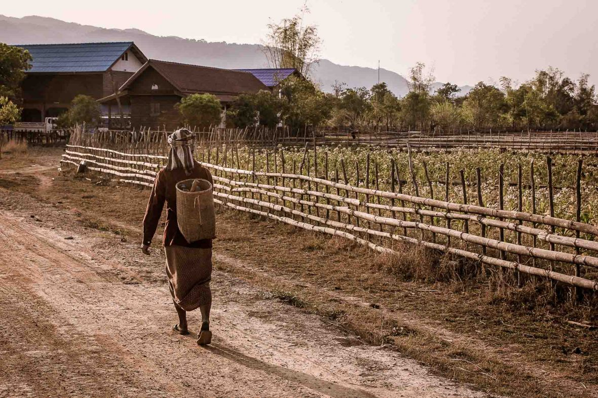 A local woman walks through Kong Lor village in Laos' Khammuan province.