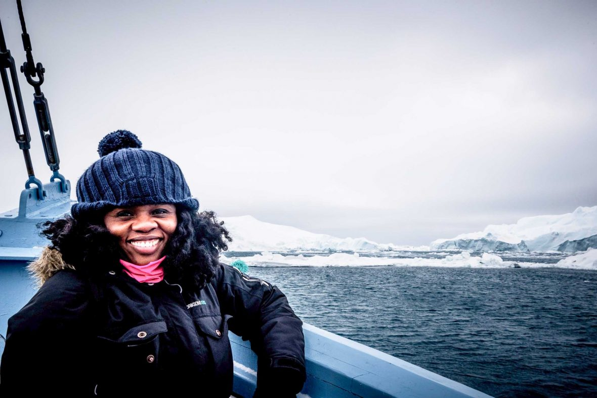Our featured contributor Lola Akinmade Åkerström, a Swedish-Nigerian travel photographer and author, during a trip to Greenland.