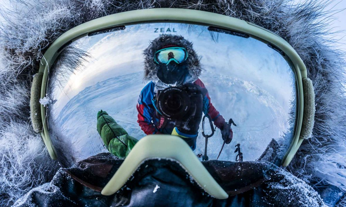 Eric Larsen is reflected in his goggles during his Great North Expedition.