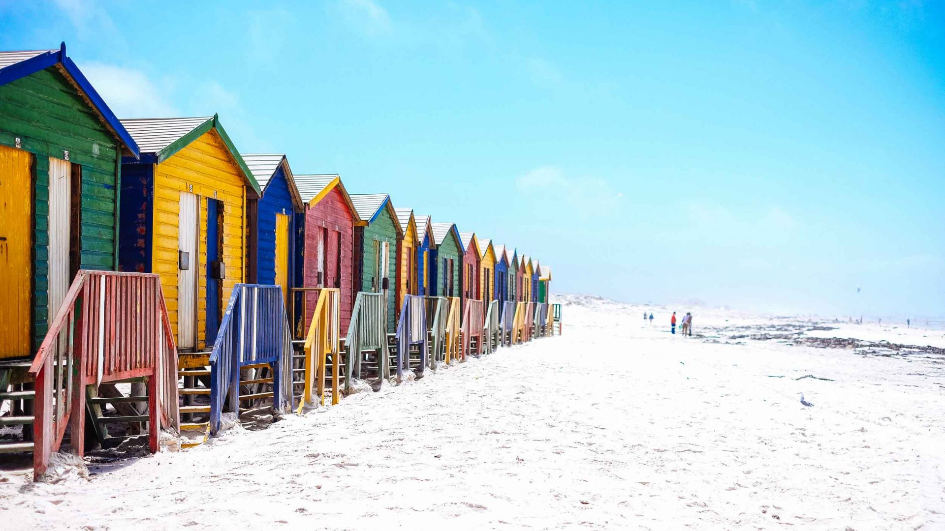 The white sands and colored beach shacks at Muizenberg, Cape Town, South Africa.