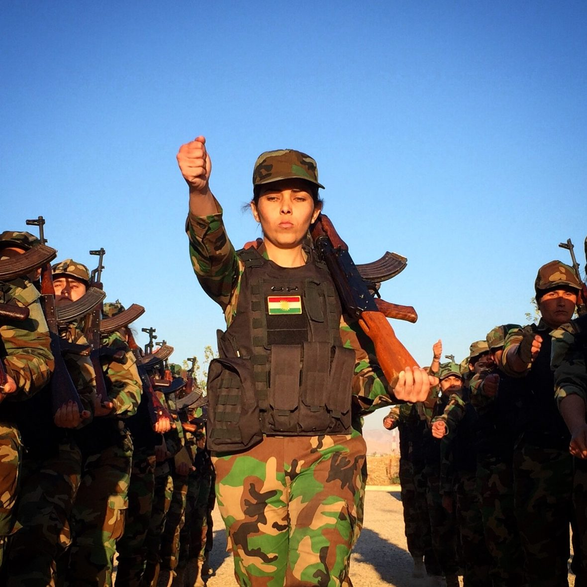 A female soldier marches defiantly in Iraqi Kurdistan.