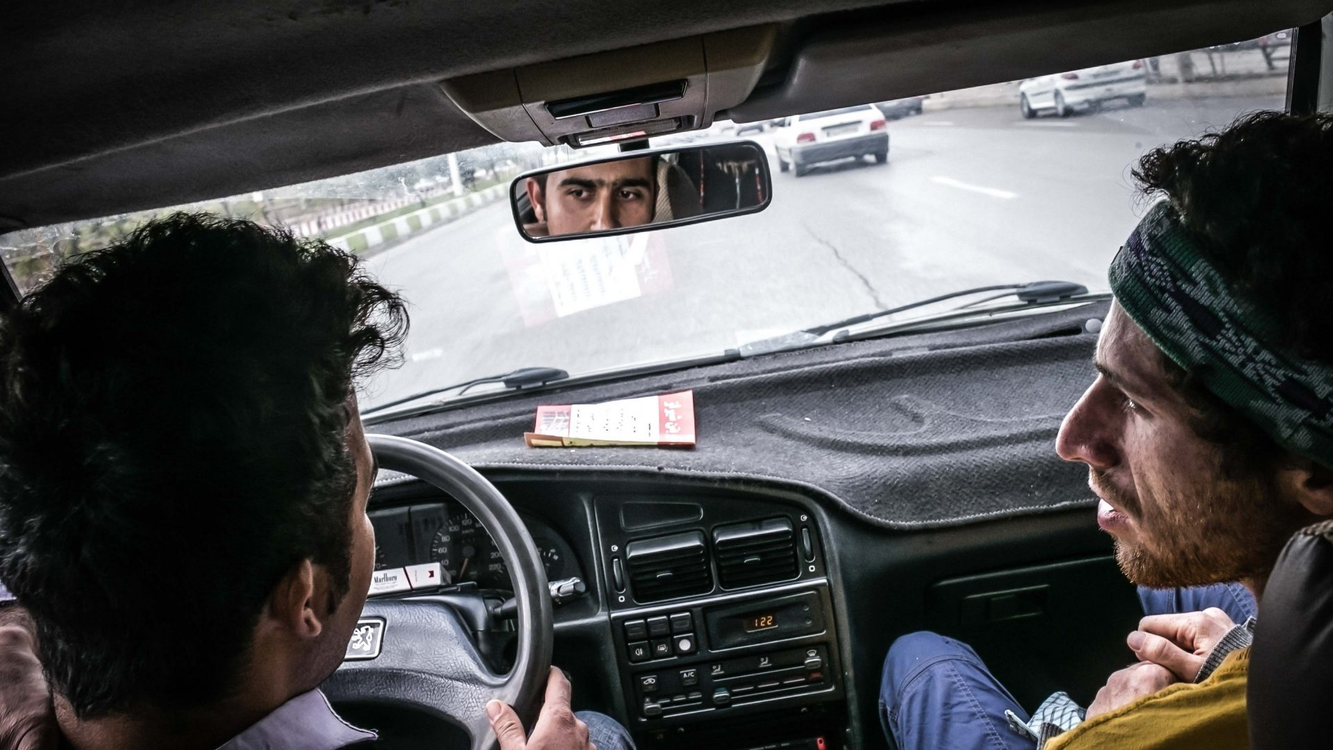 Ershad talking with Eshad, a young man who stopped to pick us up and drove us to Ghalat.