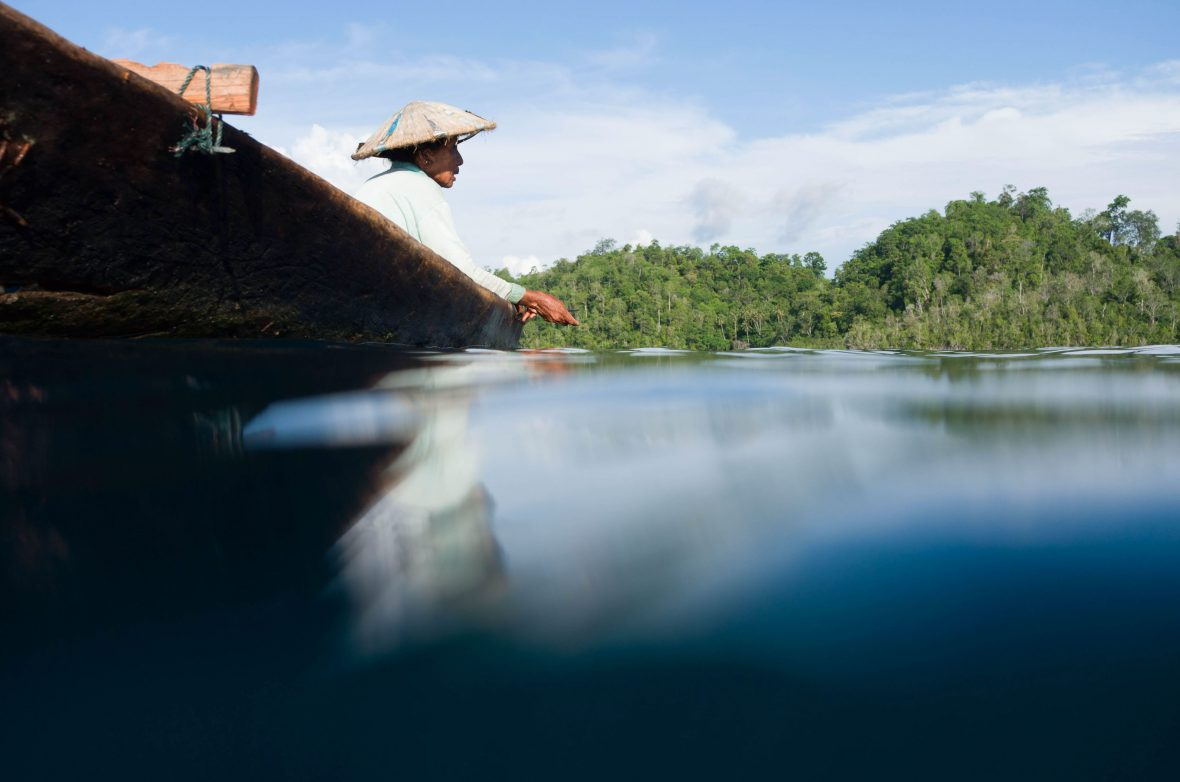 This Bajau sea gypsy woman is fishing for her family in the warm waters of the Togian islands in Indonesia.