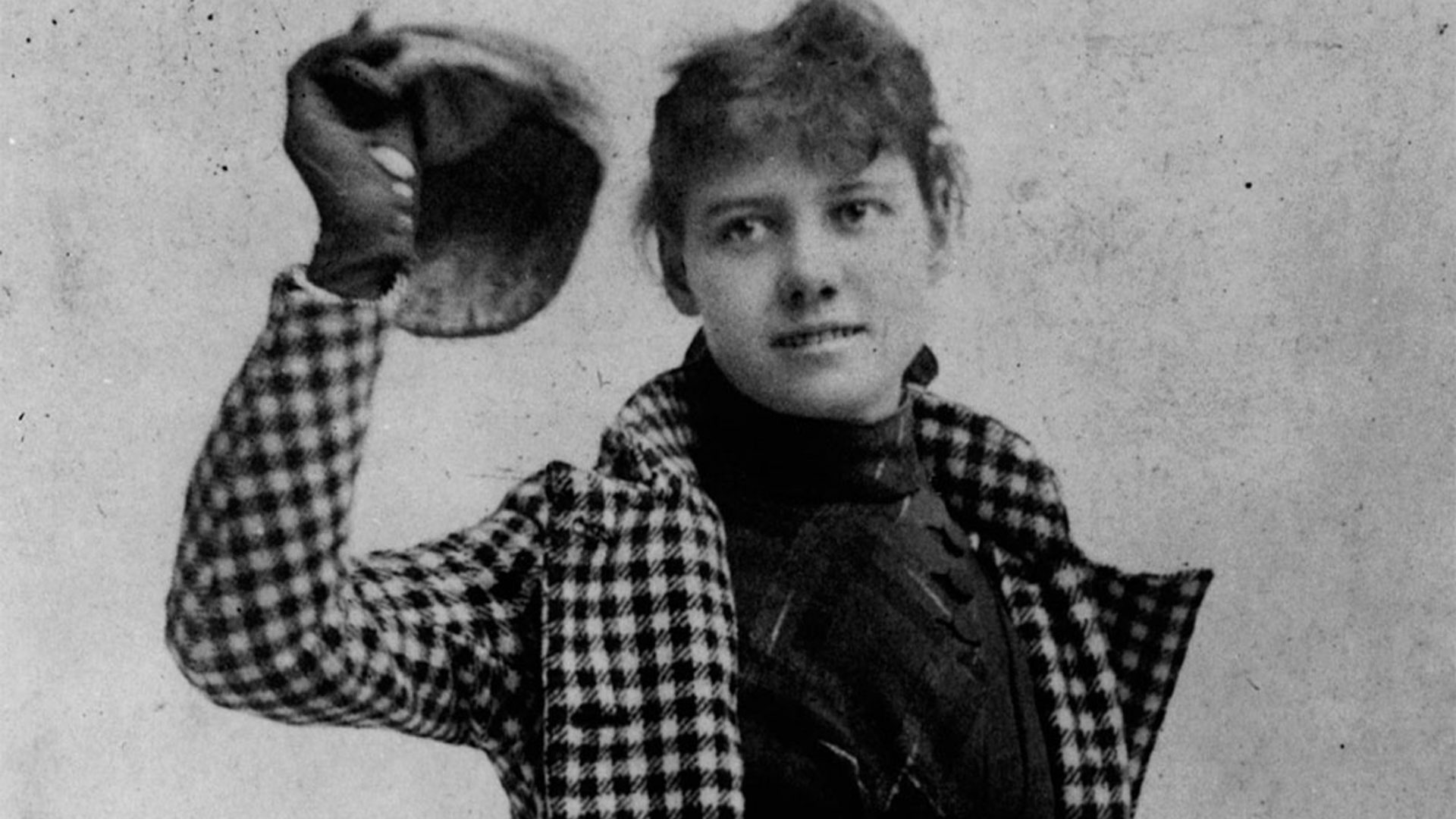 A black and white photo of Nelly Bly who traveled around the world in just 72 days..