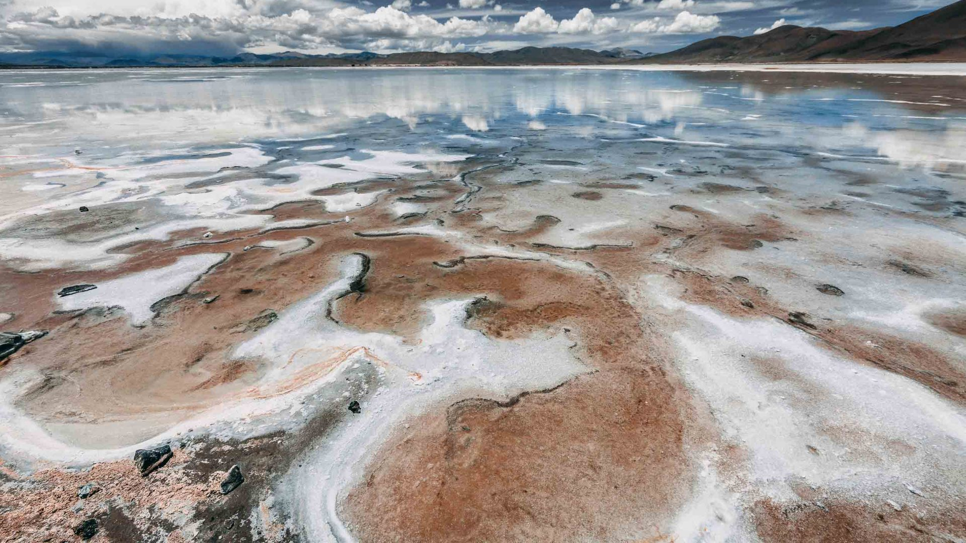 Clouds are reflected in the saline pools of Salta, Argentina.