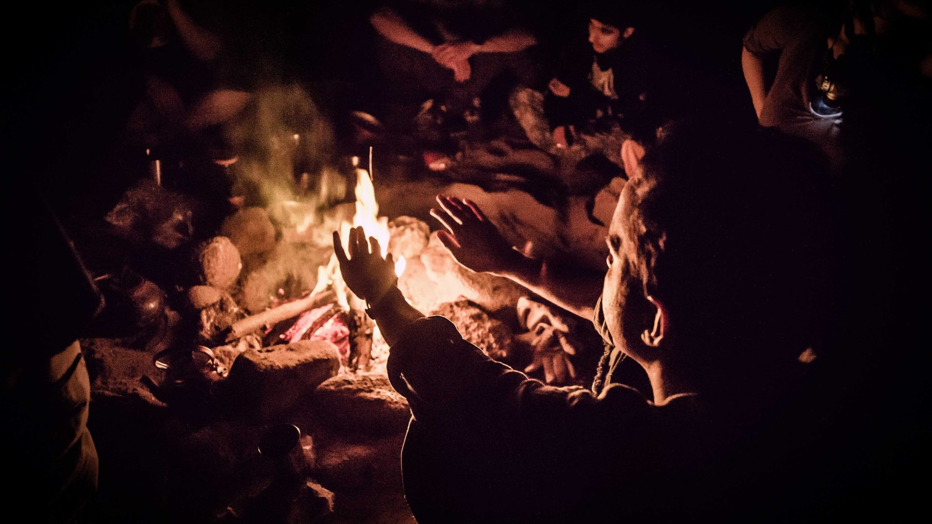 A fire crackles during a party in Tehran.