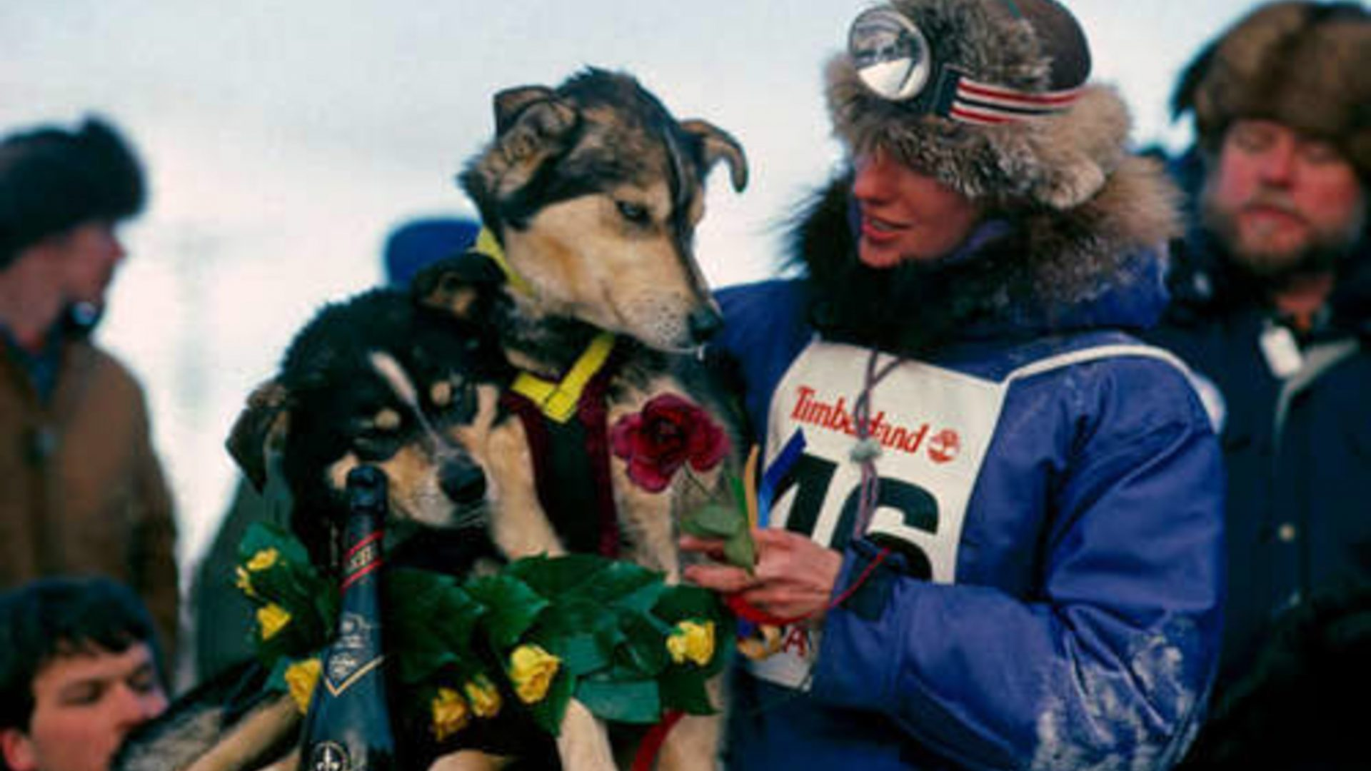 American dog musher Libby Riddles celebrates her win at the Iditarod Trail Sled Dog Race.