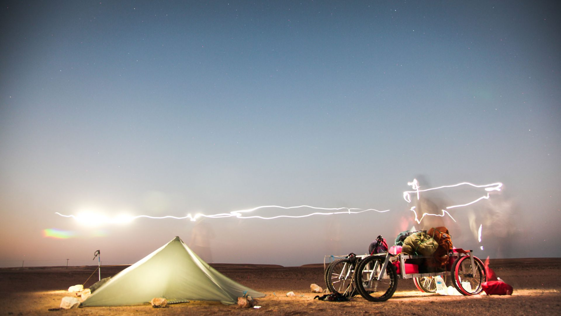 Camping at night in the Empty Quarter.