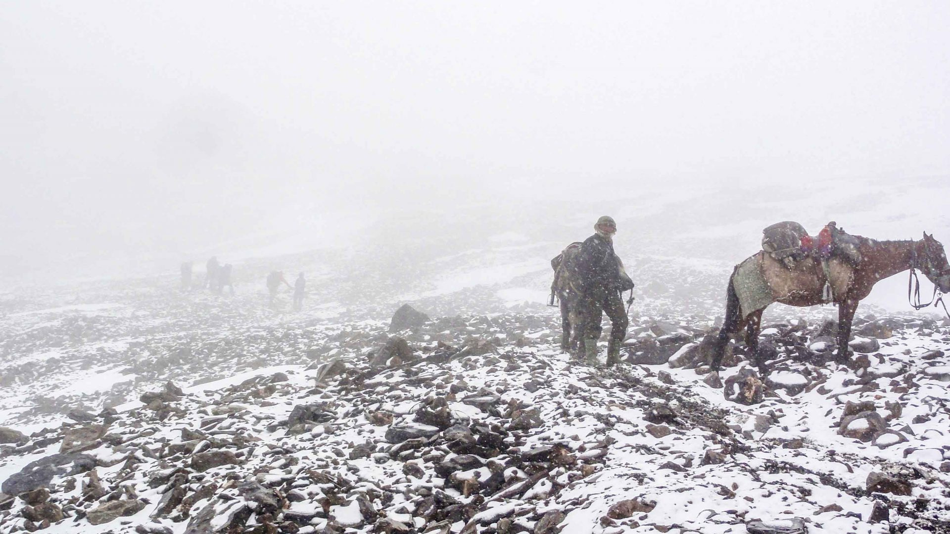 Travelers hike through the snow in the Wakhan, Afghanistan.