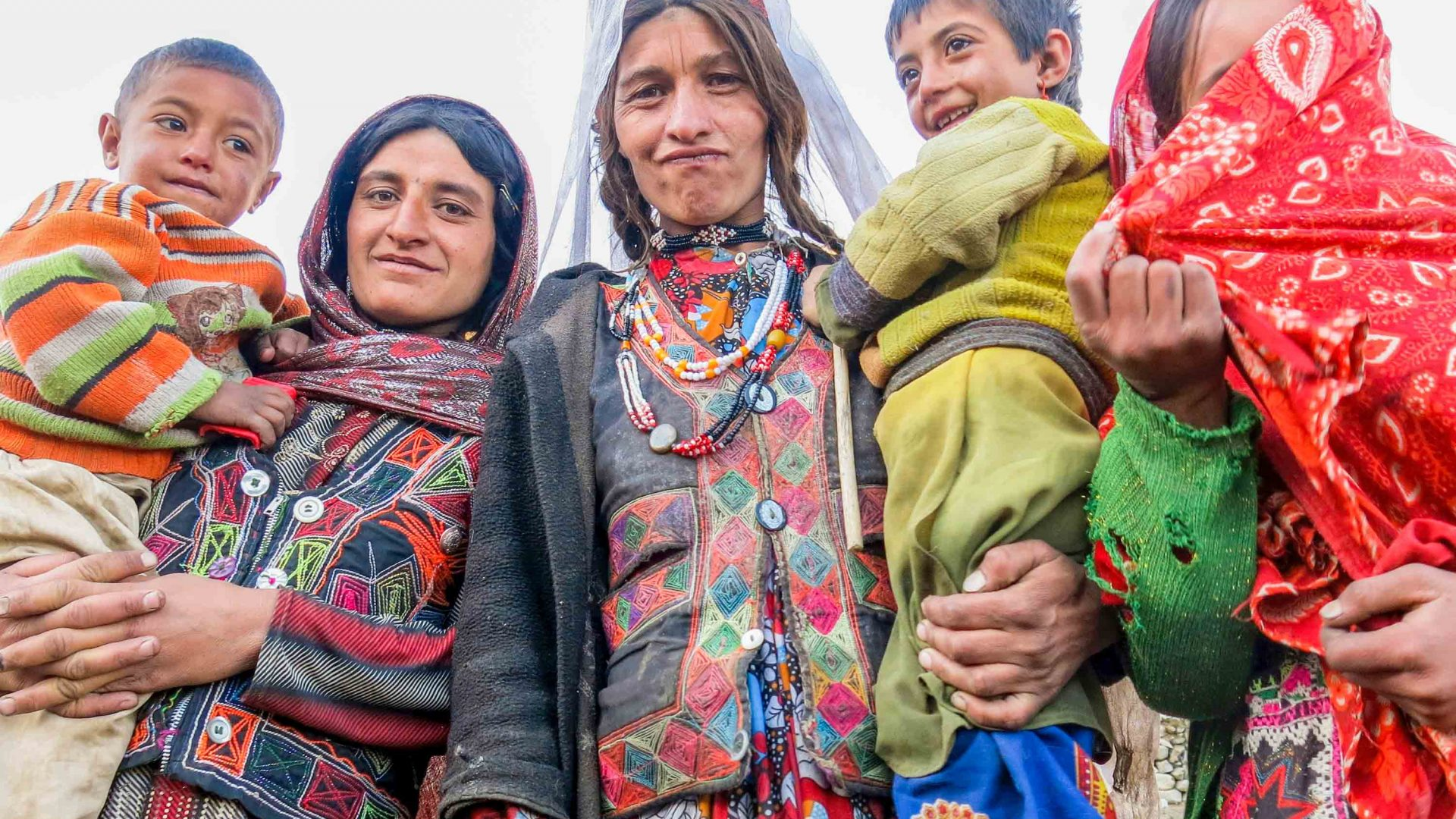 Wakhan is home to around 10,000 nomadic people of the Wakhi and Kyrghiz tribes. Here women and children pose in their traditional clothes.