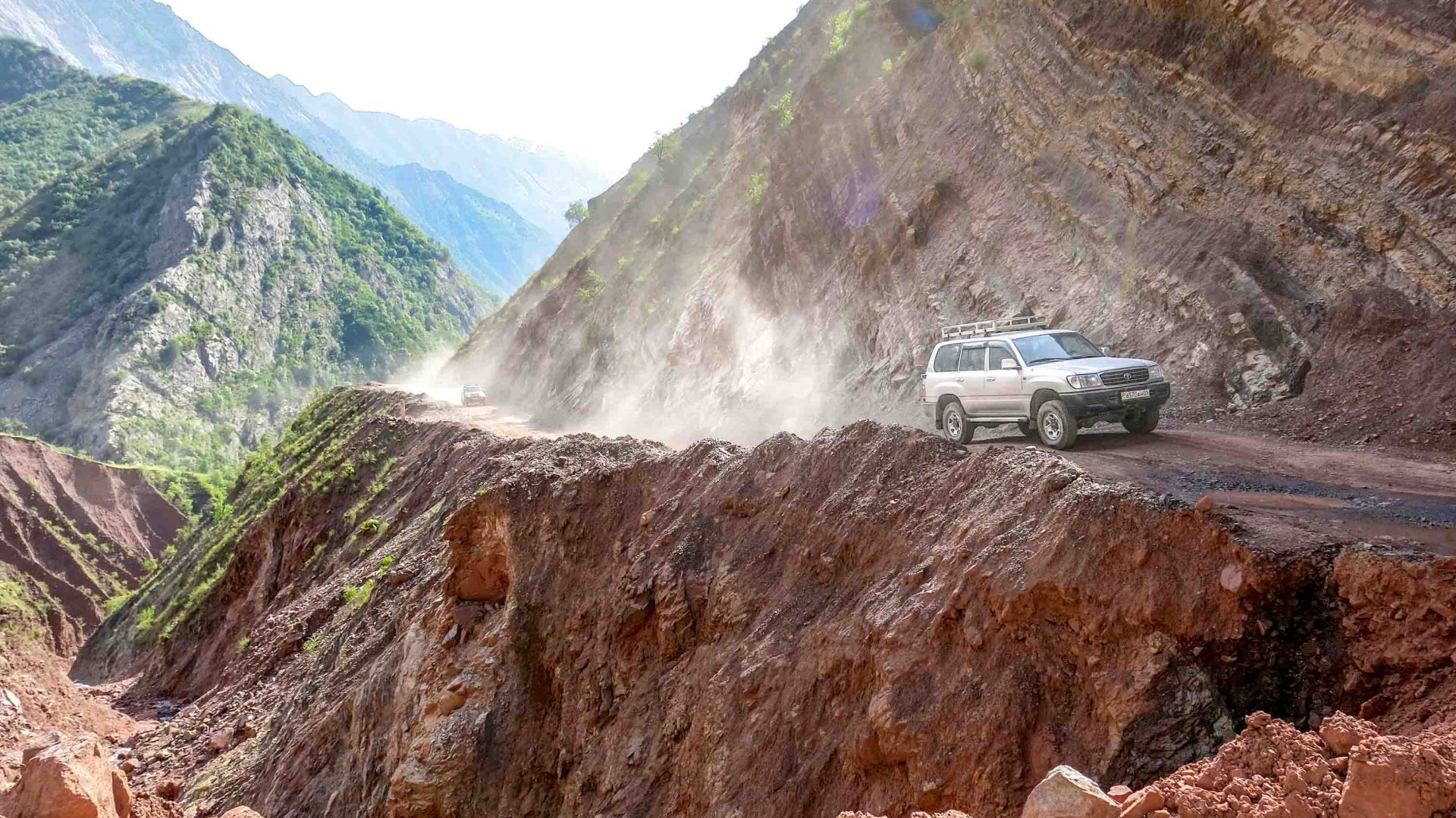 A jeep carrying travelers drives along a treacherous road in the Wakhan, Afghanistan.