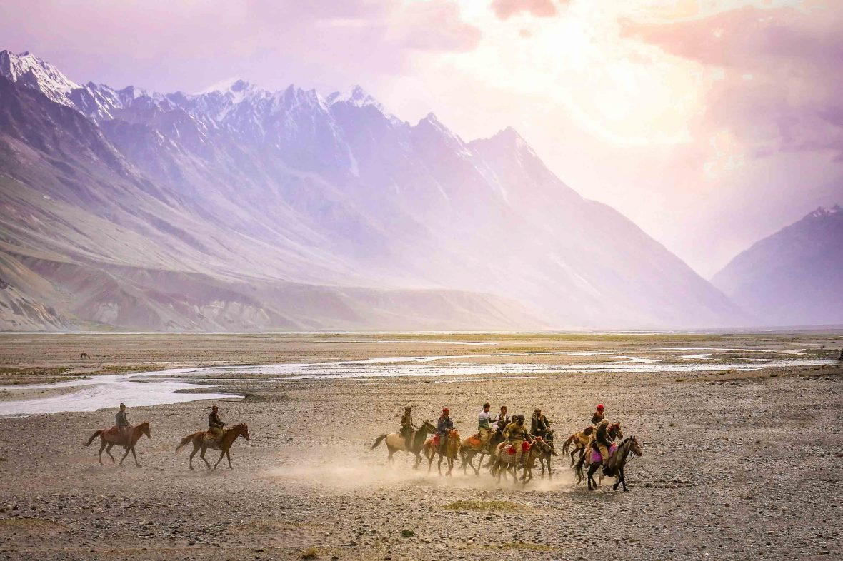 Buzkashi, an ancient game that involves wrangling over the headless carcass of a slaughtered goat.