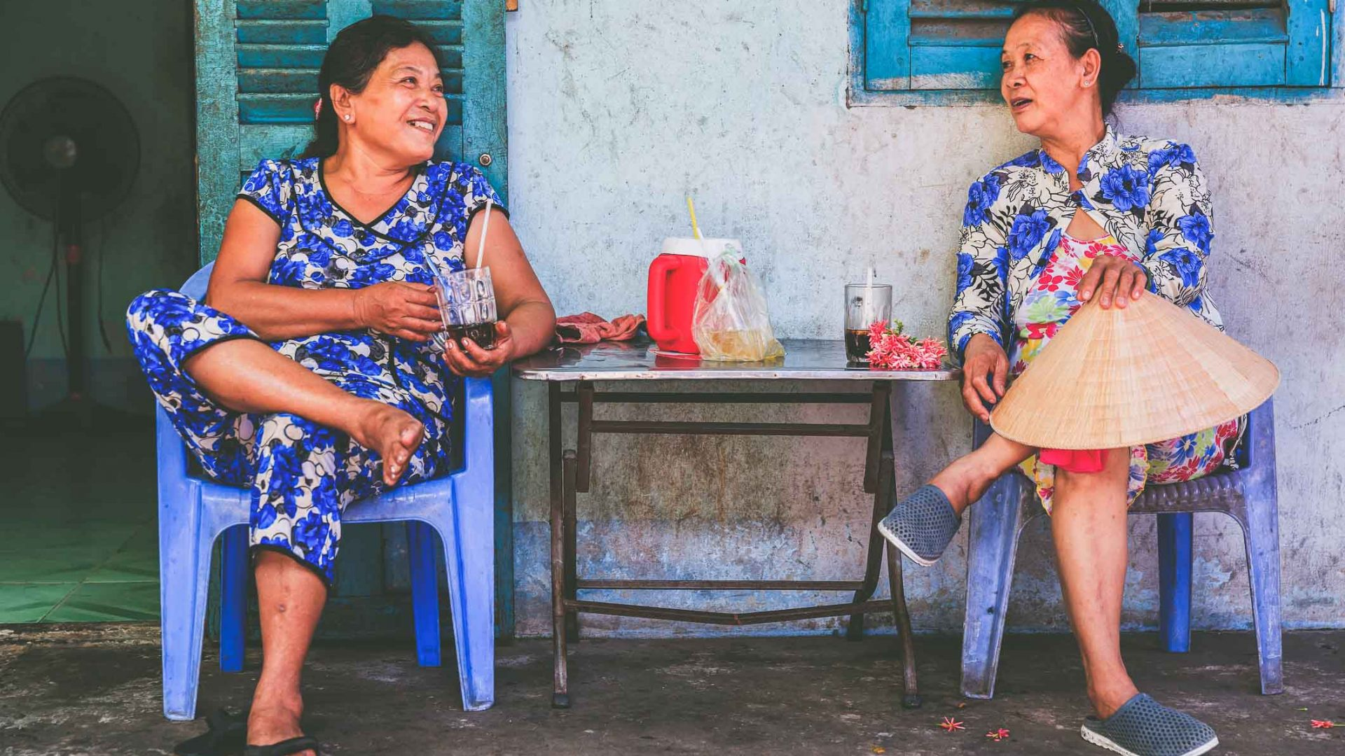 Two women on the Mekong River in Vietnam enjoy a traditional coffee together.