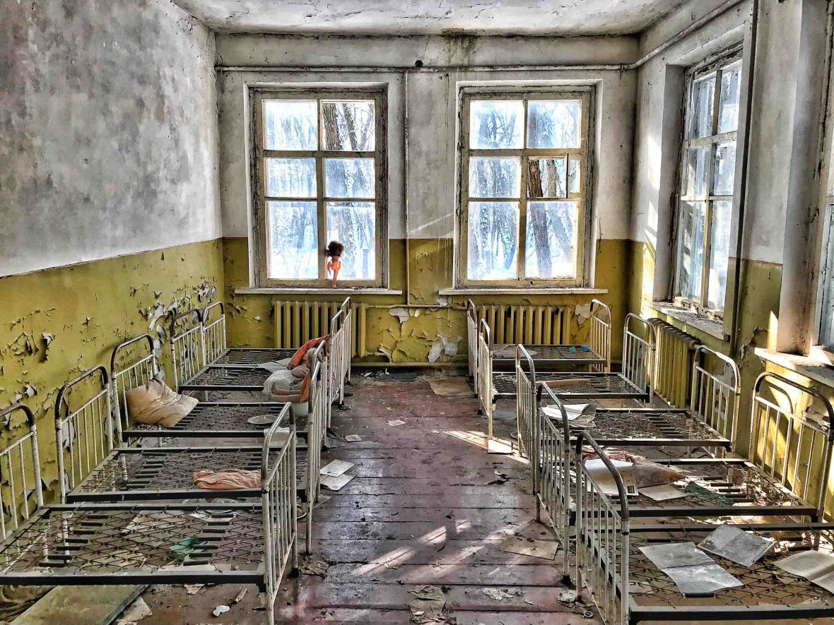 The abandoned kindergarden in Kopachy remains strewn with books, dirt-blackened dolls and empty beds.