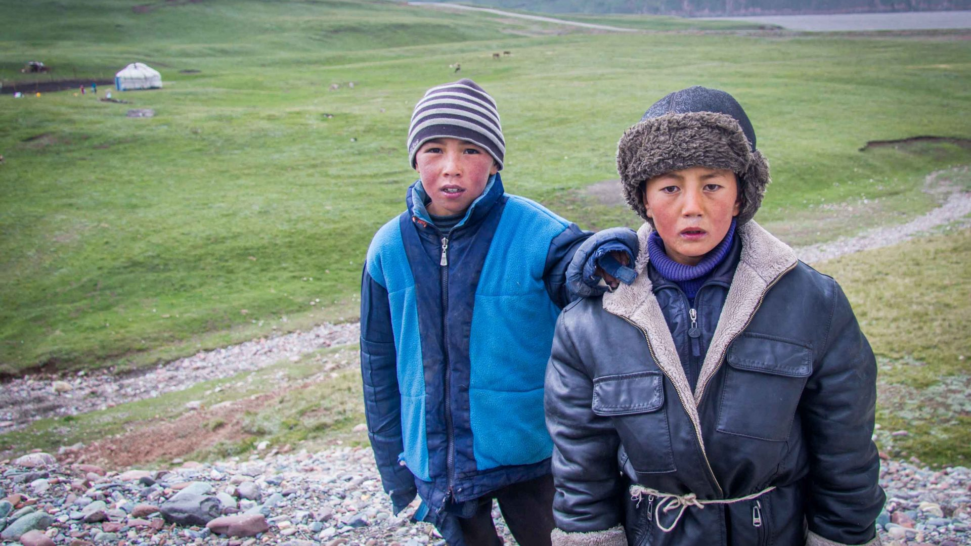 Green pastures and friendly faces in Kyrgyzstan.
