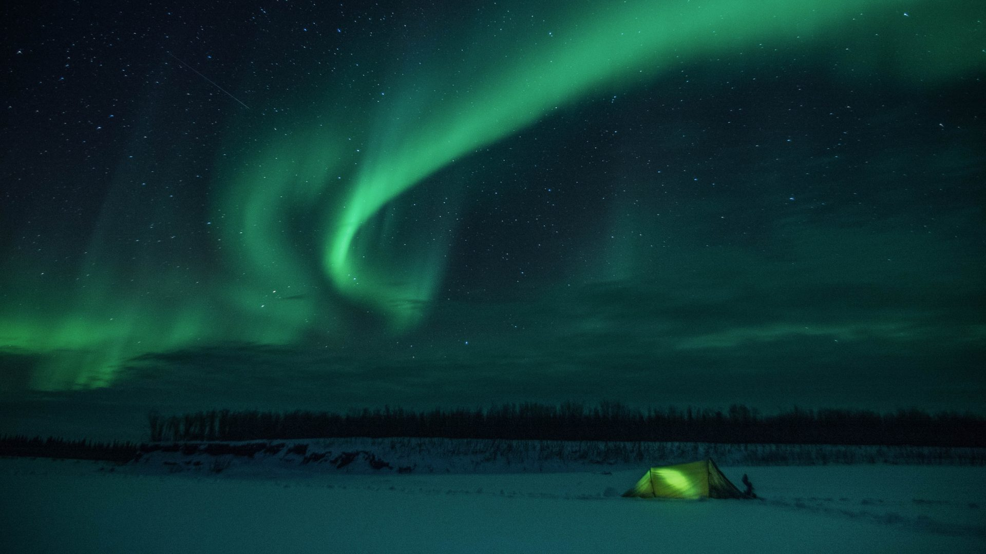 Spending a night under the northern lights in the Canadian Arctic.