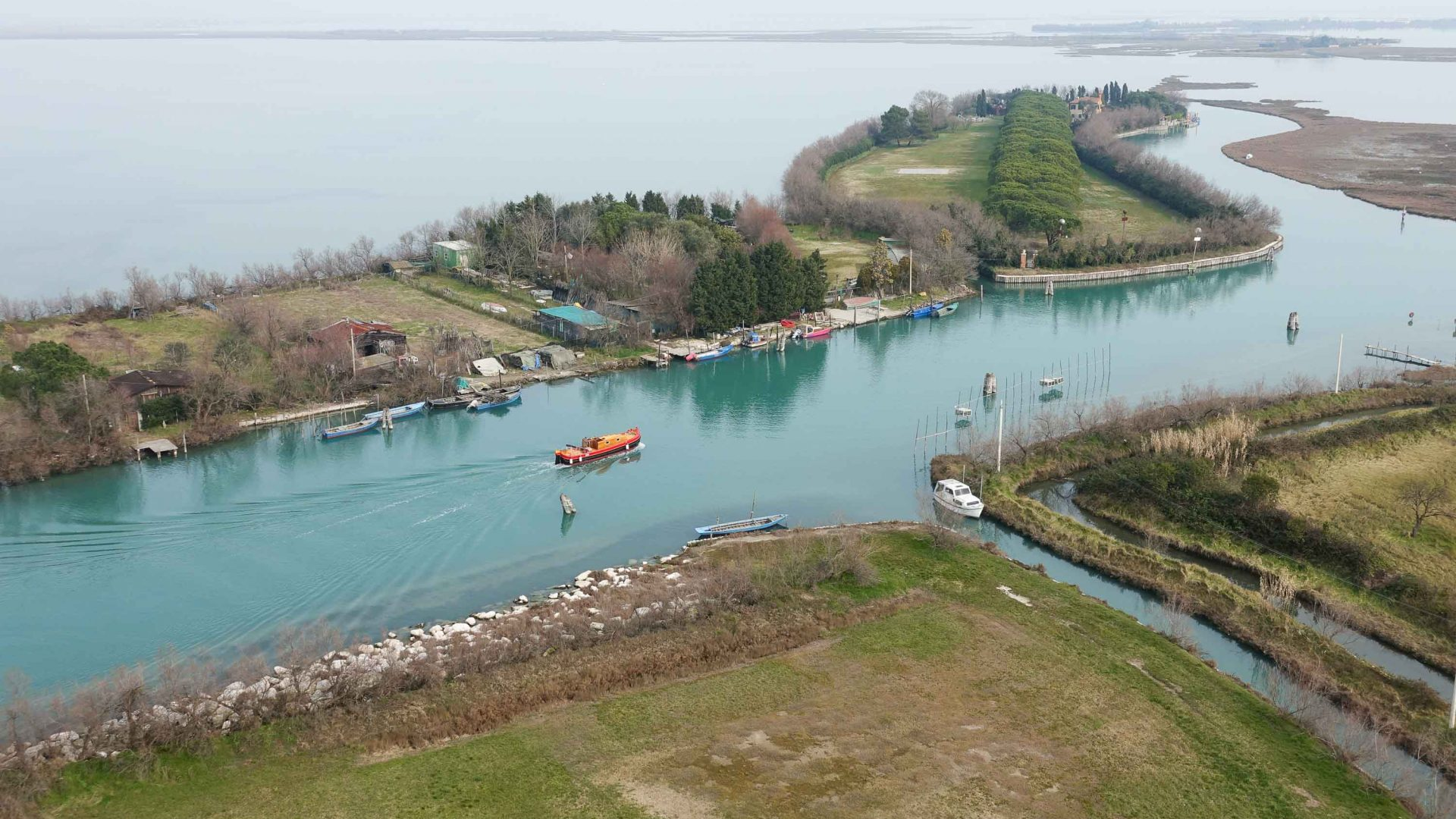 View of the bragozzo boat from the bell tower on the island of Torcello.