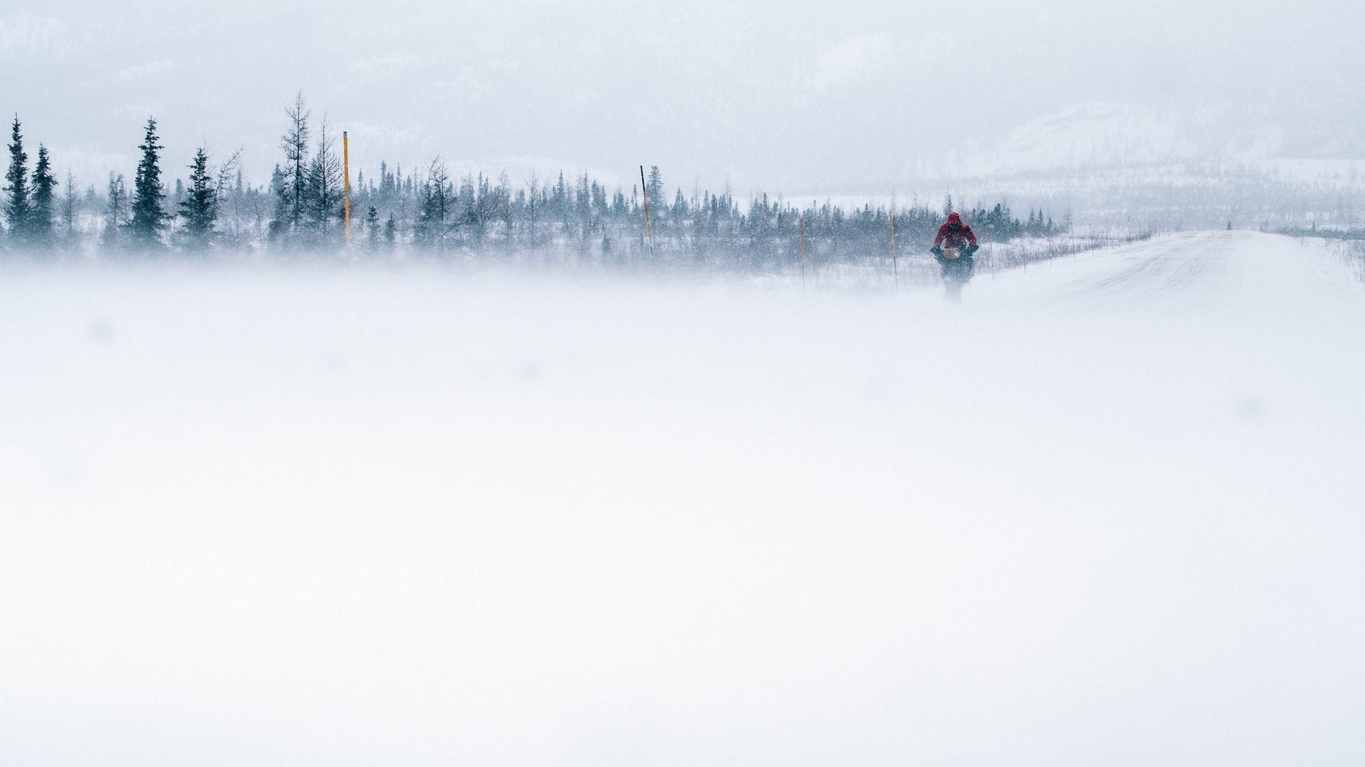 Tackling a snow storm along the Dempster Highway, Canada.
