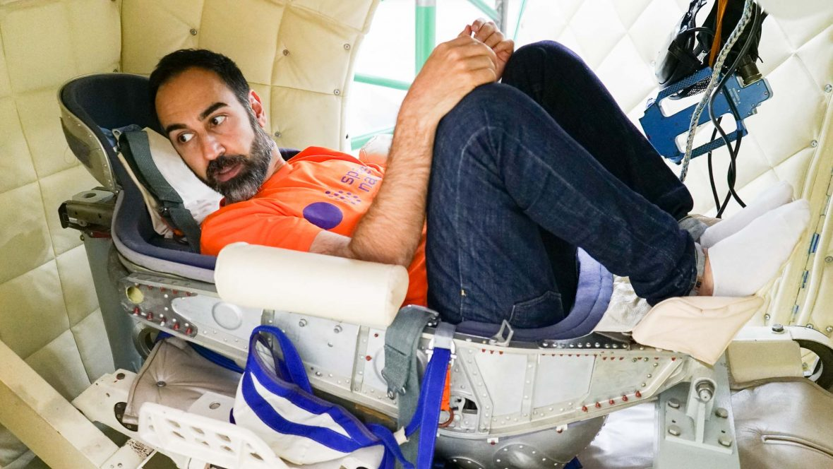One of Spacenation.org's founders, Mazdak Nassir reclines in a space pod.