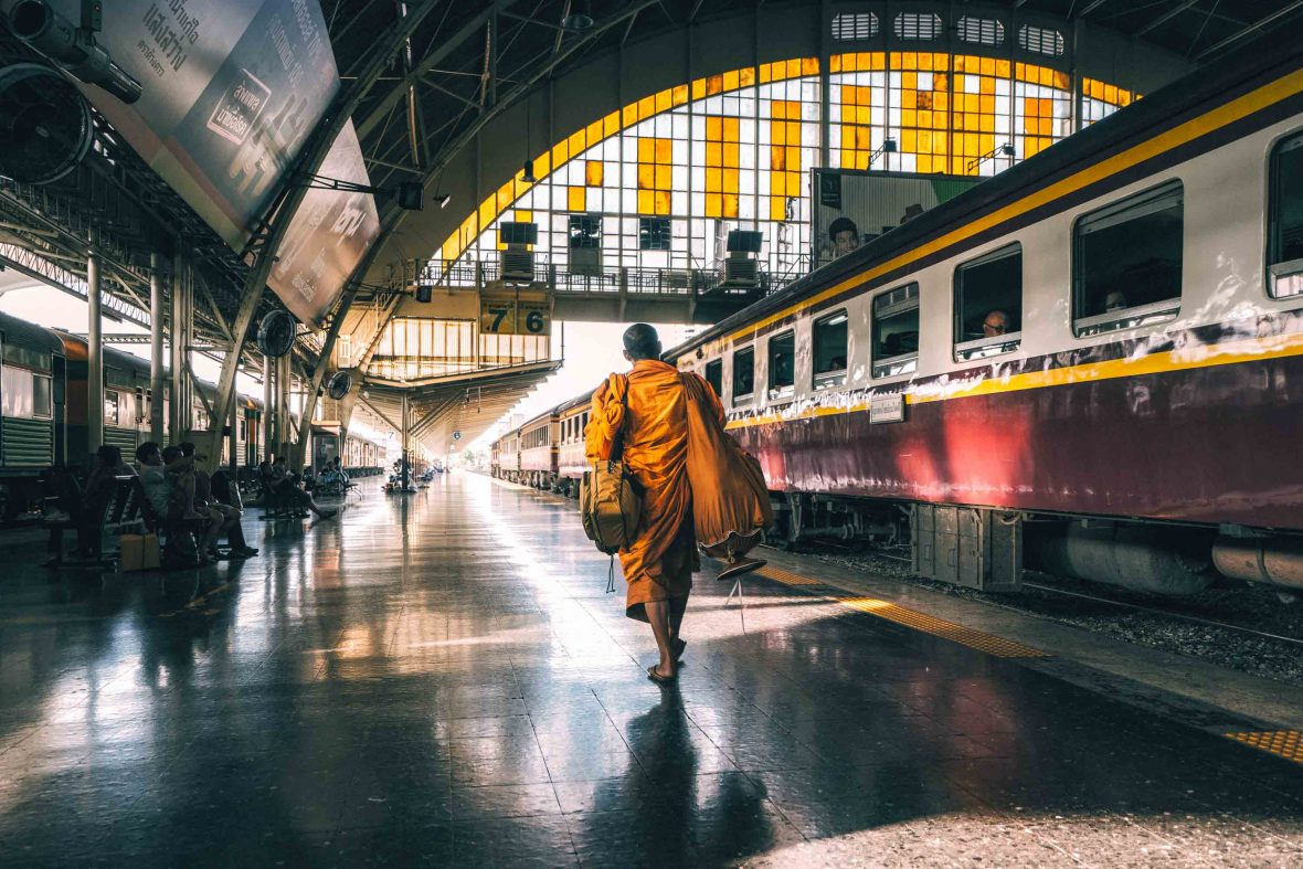 A monk walks along the platform of Hua Lamphong station in Bangkok, Thailand.