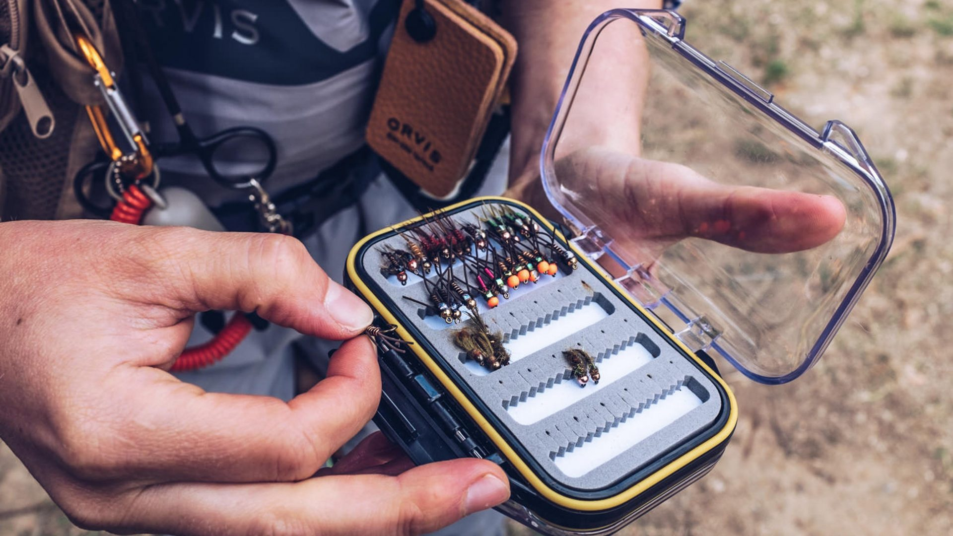 Fishing guide Charley May selects the best fly for the job from her tackle box.