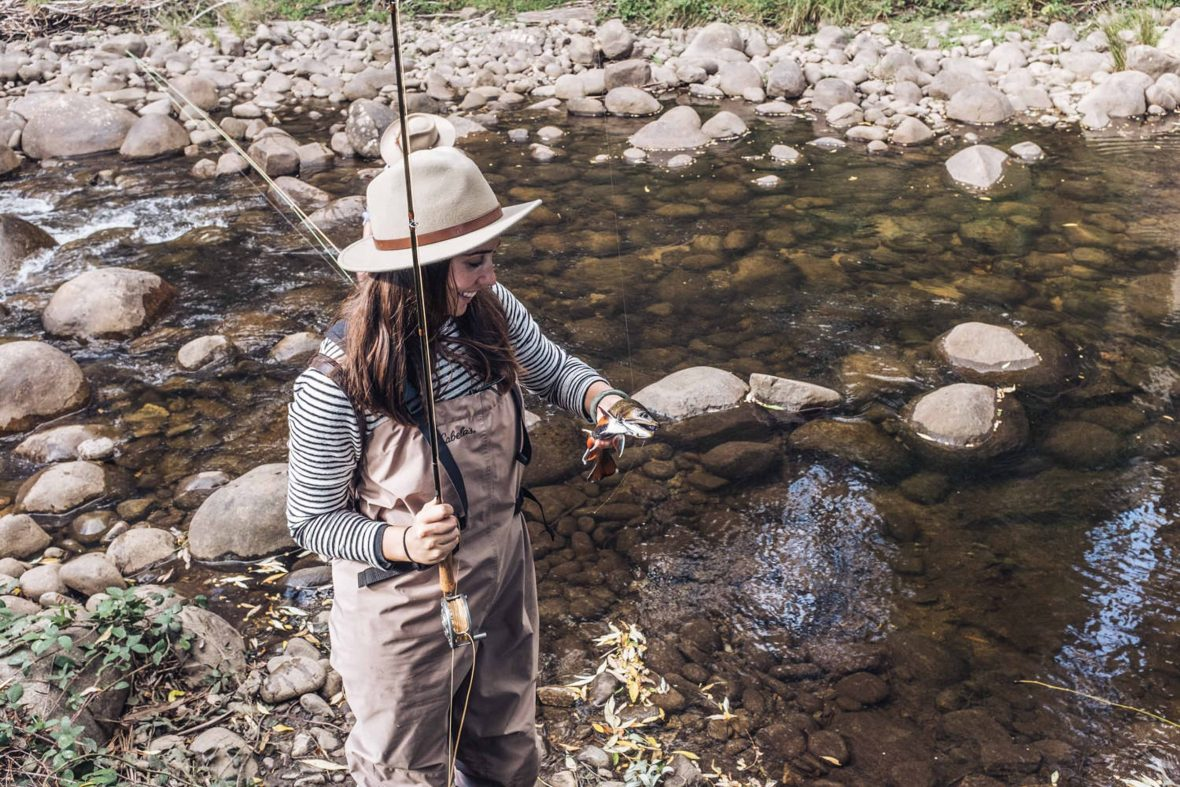 Tayla Gentle poses with a trout in Victoria's High Country.