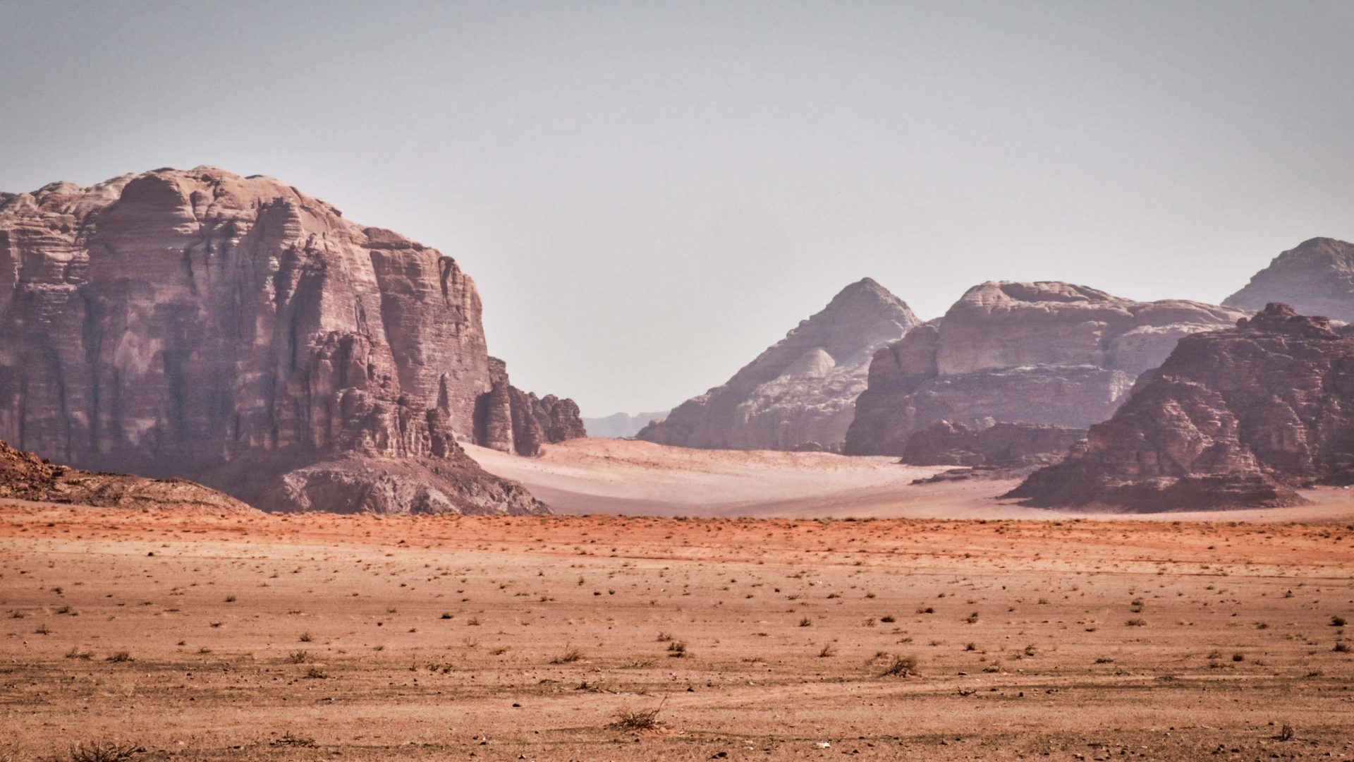 The great mountains of Wadi Rum jut out of the desert sands on the Jordan Trail.