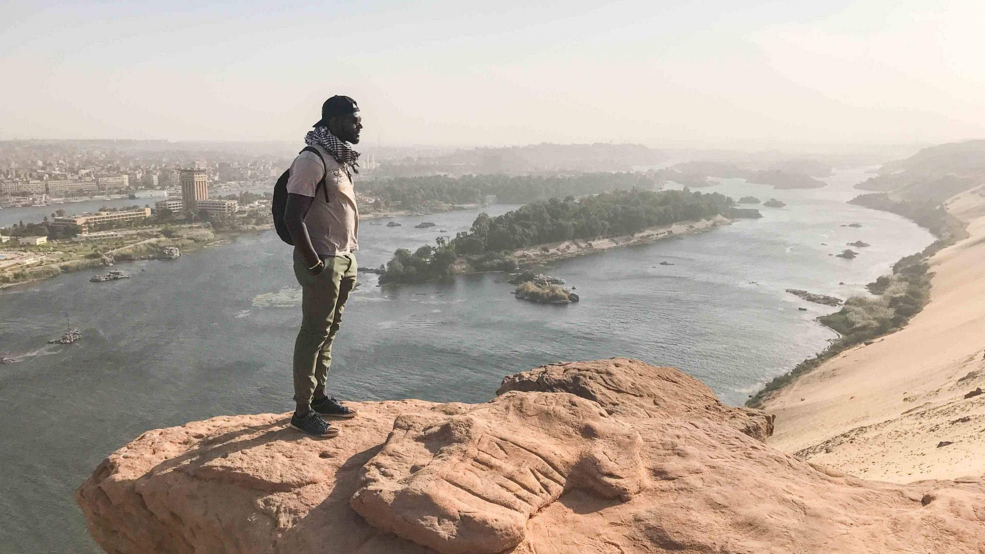 Mario Rigby on a hilltop overlooking the city of Aswan, Egypt.