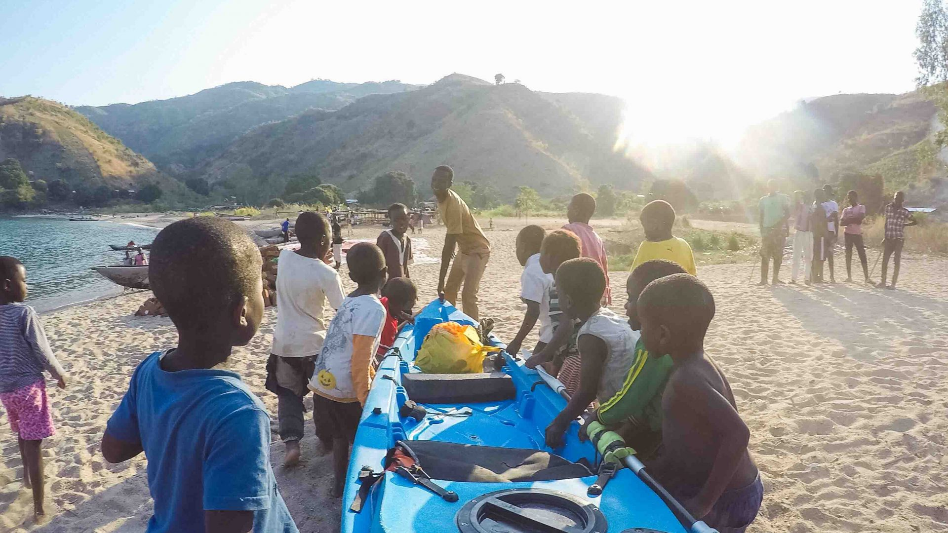 Near the end of Mario Rigby's expedition in a village the kids helped him move his kayak.
