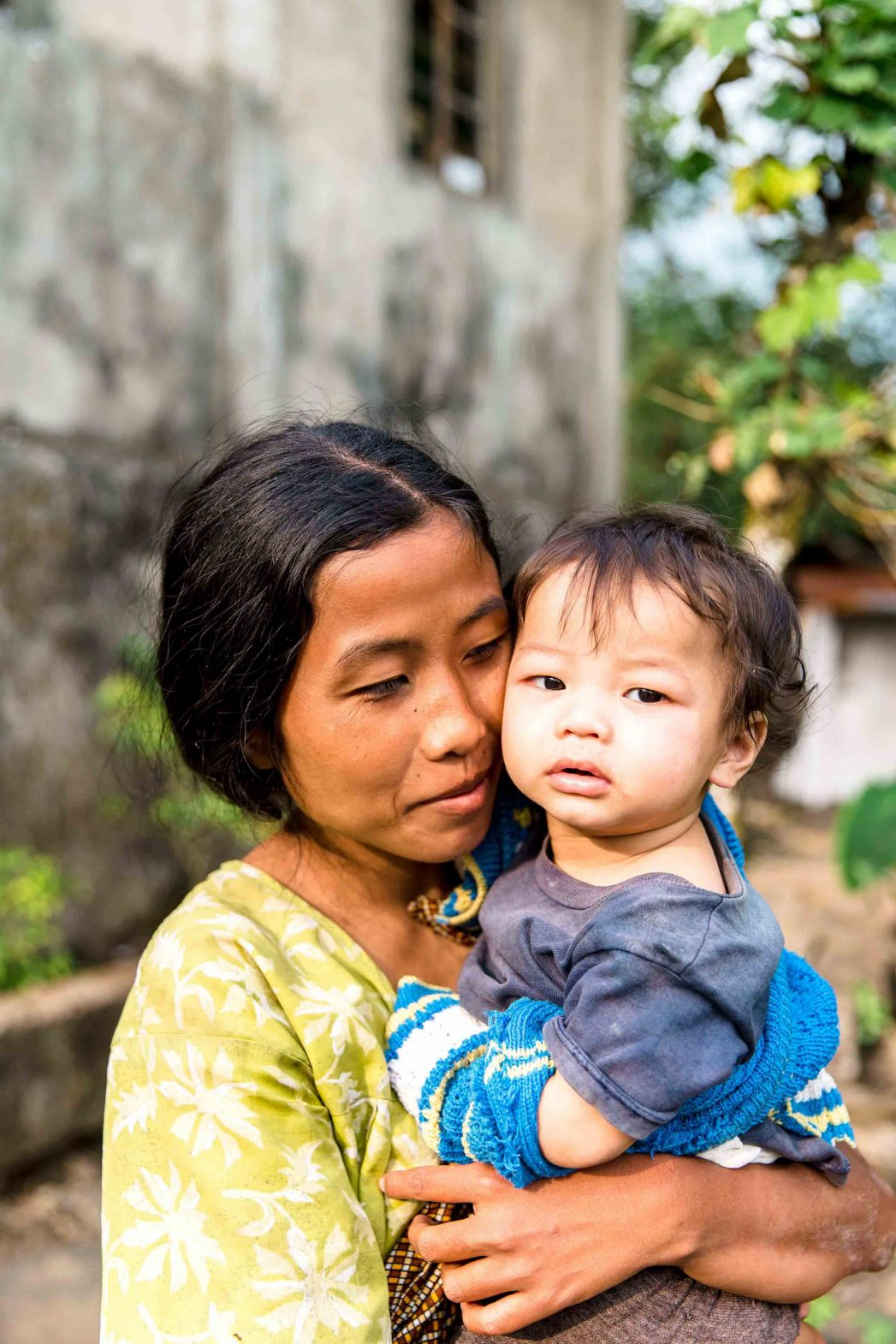 A Khasi woman and her young child in the village of Nongriat in Meghalaya, India.