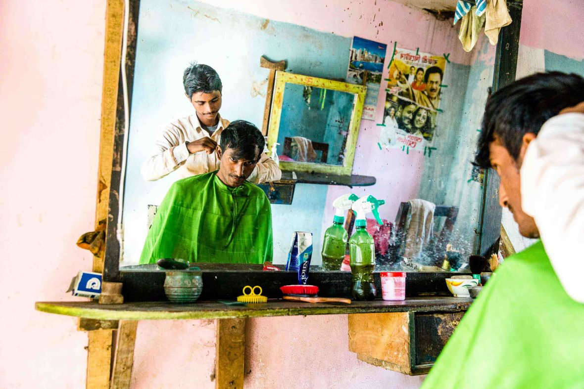 A pink barber shop in a roadside town in northern Assam, India.
