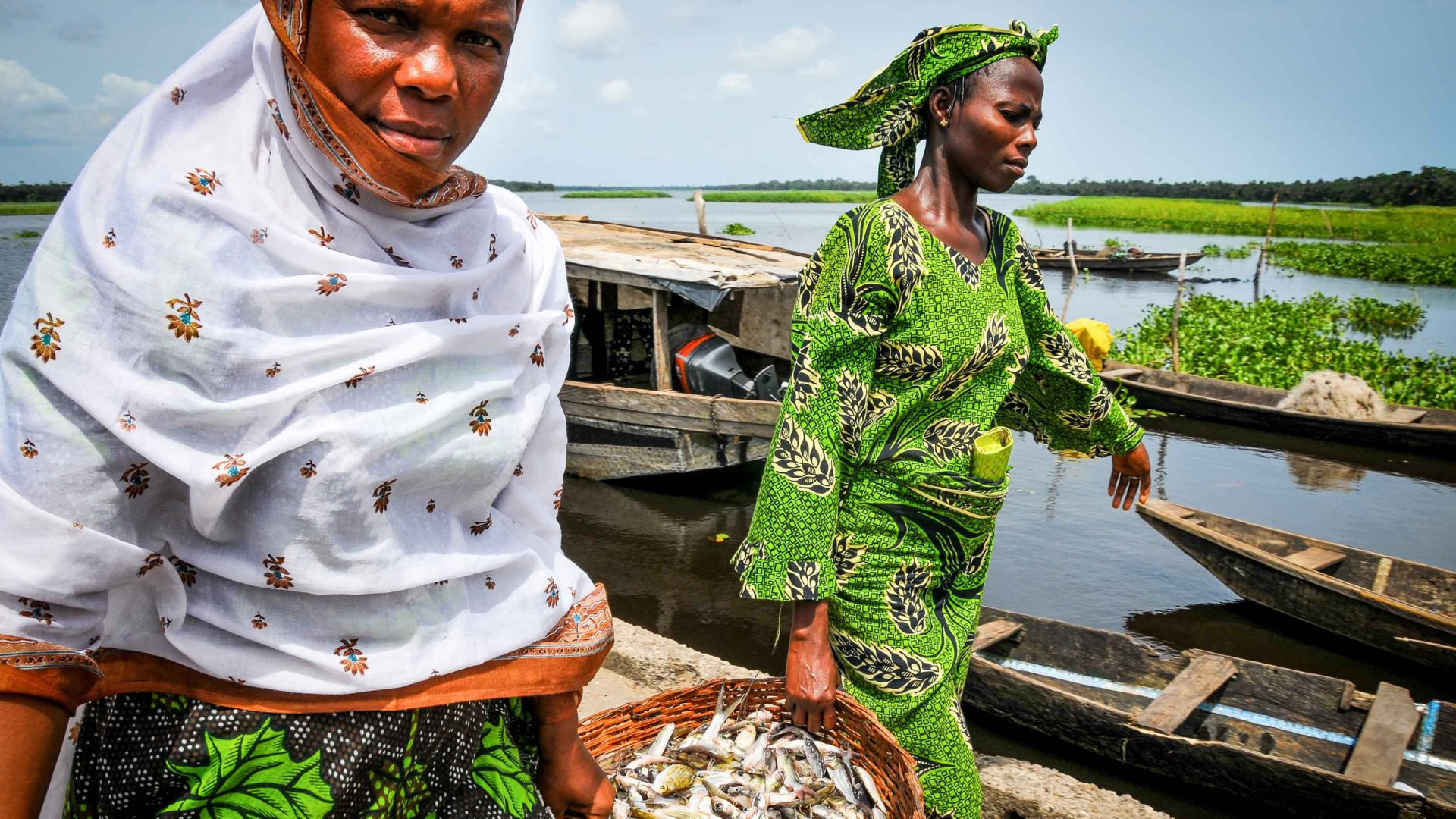 Women carry fish in Lagos, Nigeria.