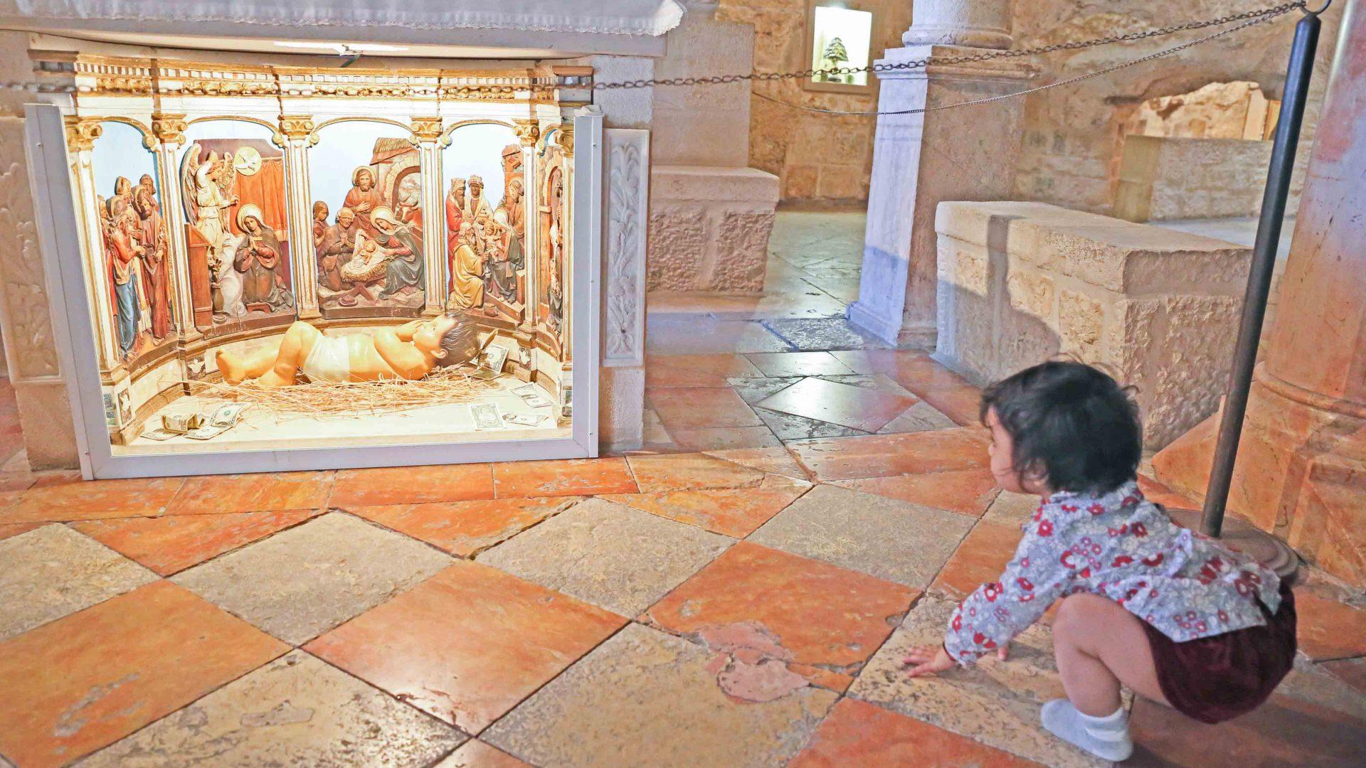 Baby Gia Sereni at a religious shrine Bethlehem, Palestine.
