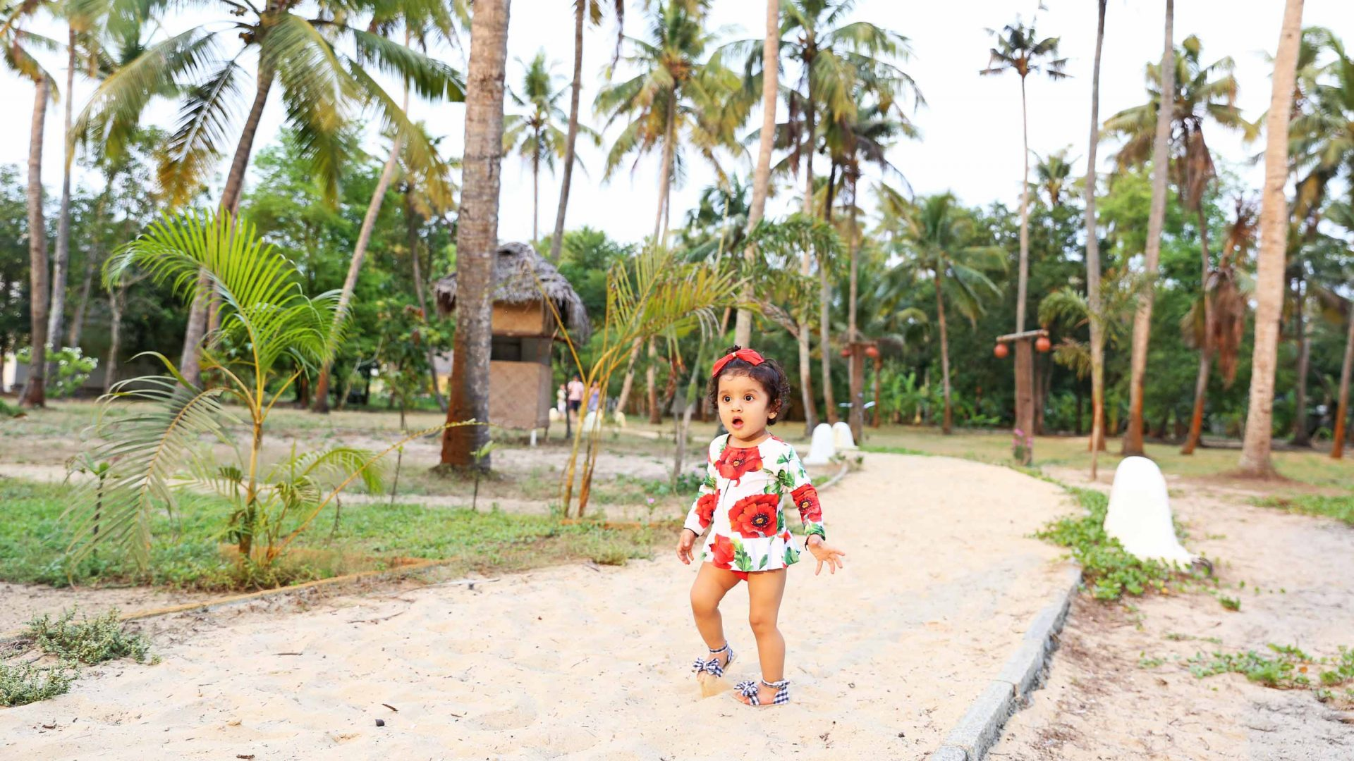 Baby Gia Sereni by the beach in Kerala, southern India, during her travels wit her mother.
