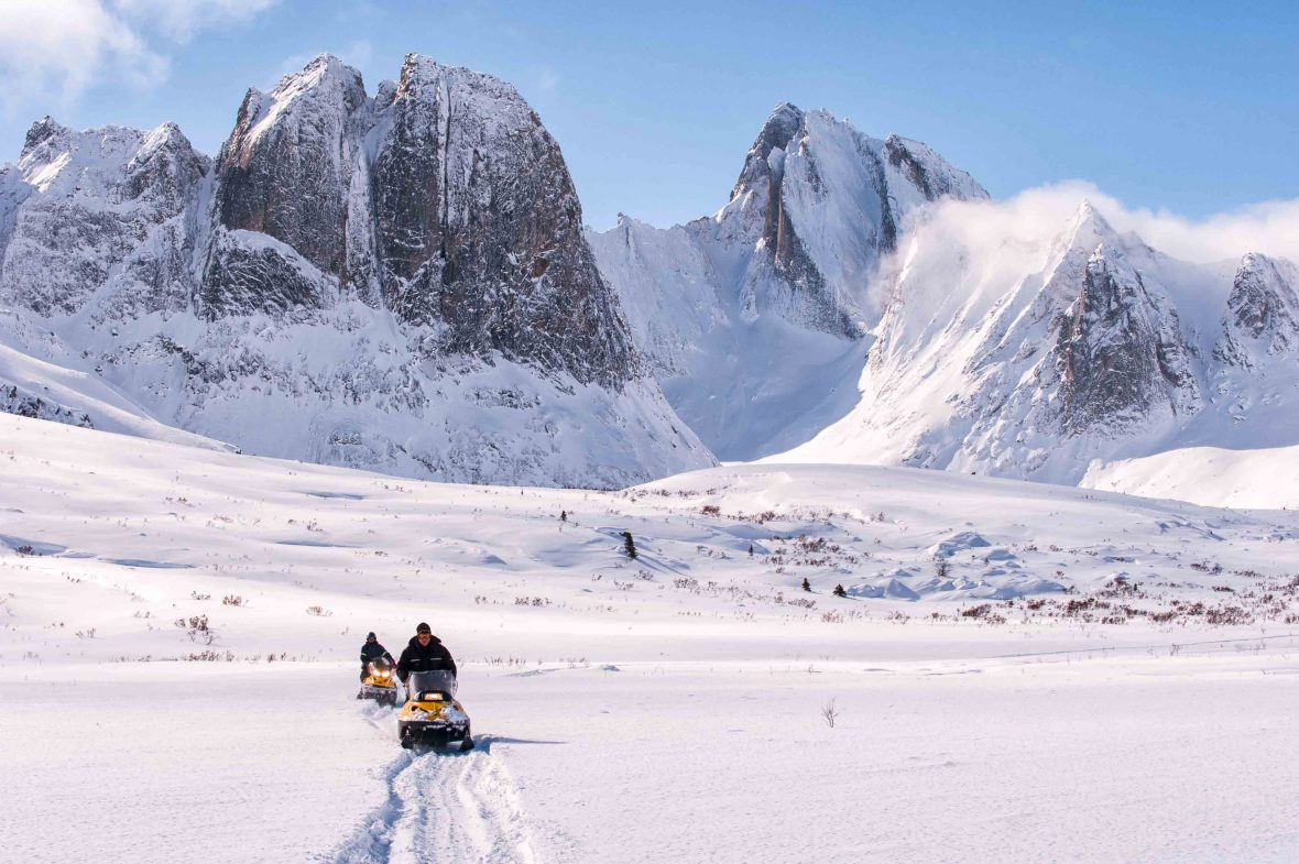 Snowmobiling in Tombstone Territorial park during spring in the Yukon.
