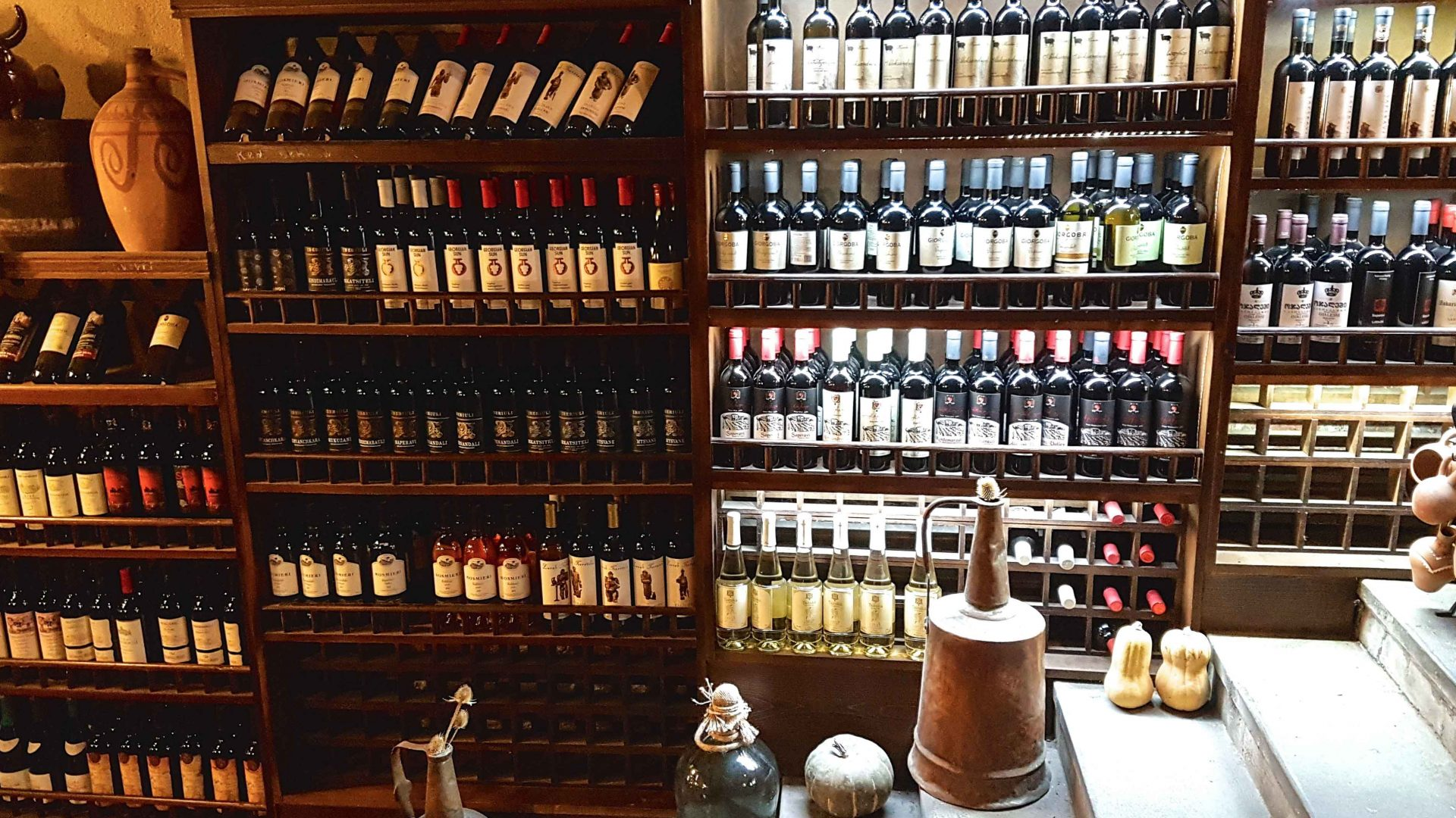 Famous Georgian natural wines displayed on a shelf.