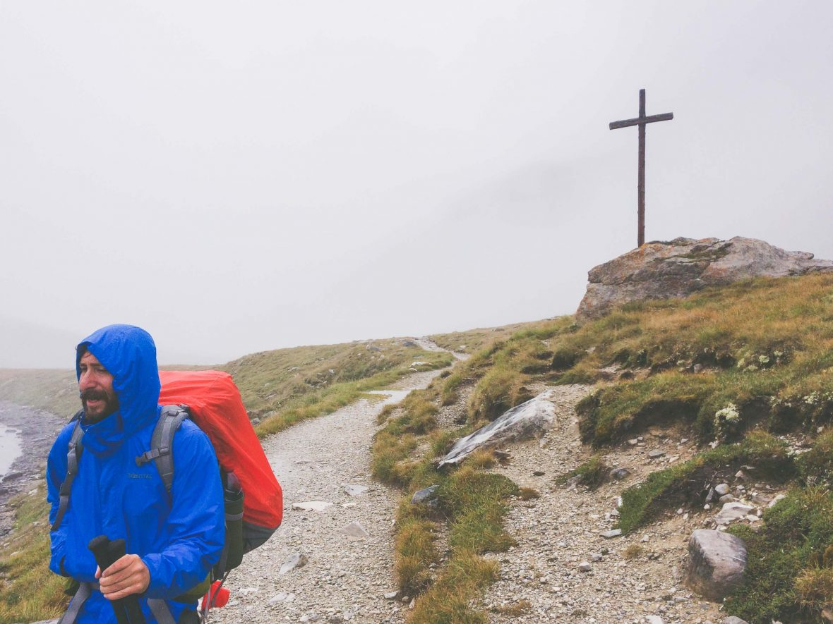 Jonathan Arlan braces against the weather during his 400 mile hike through the French Alps.