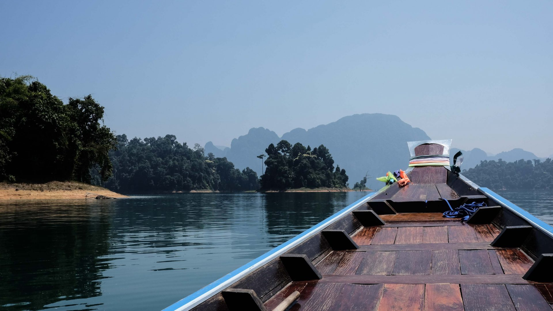 A longtail boat ride on Cheow Lan Lake in Khao Sok National Park, southern Thailand.