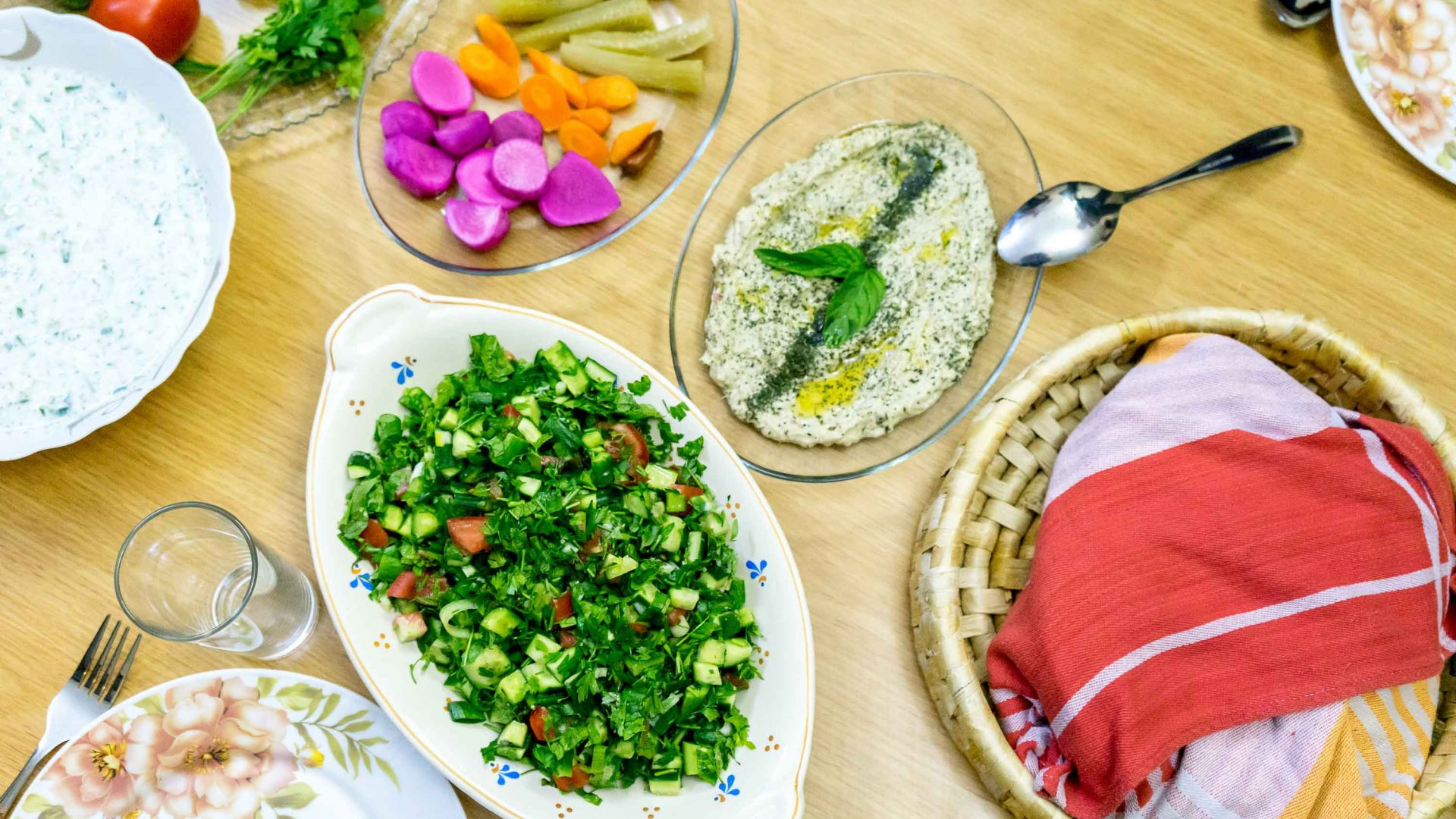 A traditional Jordanian spread at Galsoum's Kitchen including hummus, tabbouleh, and a yoghurt sauce called Cha'cheel.