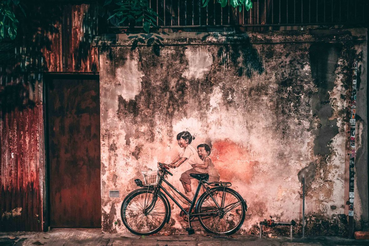 "The famous 'Little Children on a Bicycle' mural by Ernest Zacharevic, ""Malaysia's Banksy."""