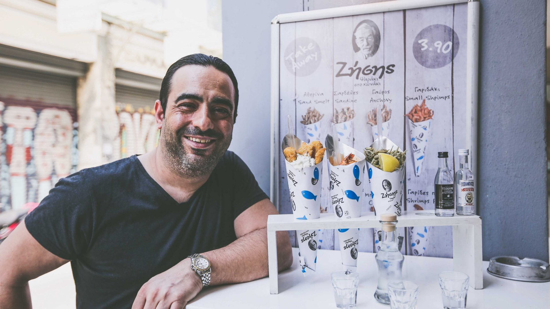 Athens street food: Zisis manager, Pantellis Michailidis, with the famed 'fish in a cone'.